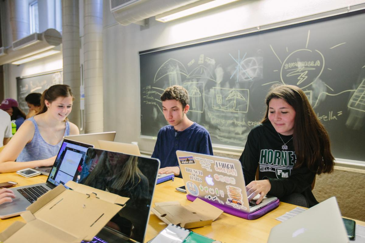 A photo of students on computers.