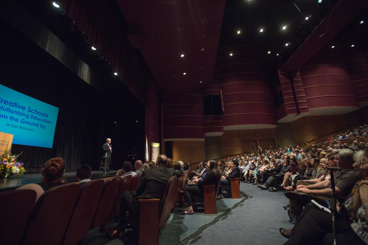 A photo of an auditorium filled with students.